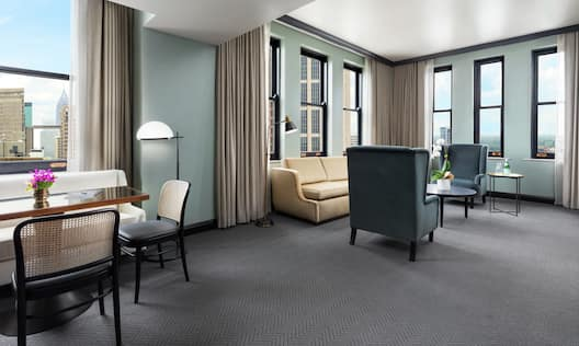 Suite with Lounge Area, Dining Area, and City View