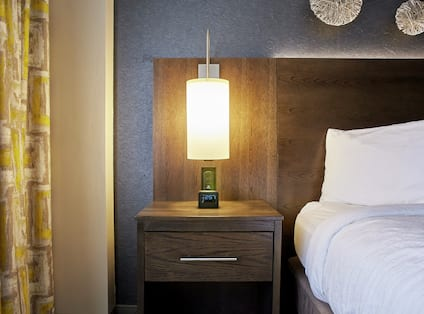 King Guestroom with Lamp and Bed Detail