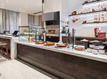 Artisanal Breakfast Area with Meat and Fruits on Counter