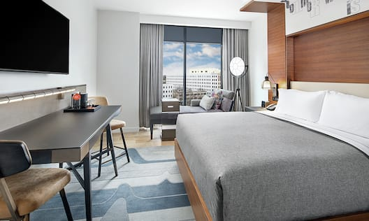 King Guestroom with Bed, Lounge Area, Outside View, Work Desk, and Room Technology