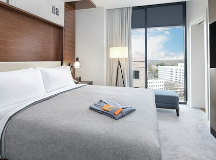 King Guestroom Suite with Bed, Lounge Area, Outside View, and Room Technology