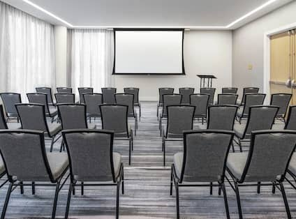 Meeting Space Theater Setup with Chairs and Room Technology