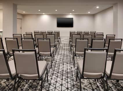 Meeting space with chairs and TV