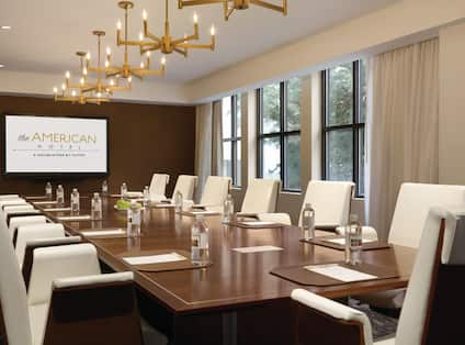 Meeting room in boardroom setup with Projector Screen