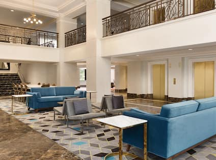 View of The Main Lobby, Upper Level, Stairs, Elevators, Comfortable Seating Area and Tables