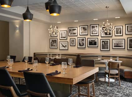 View of Wall Photography and Communal Table with comfortable seating in The Cloakroom Kitchen & Ba