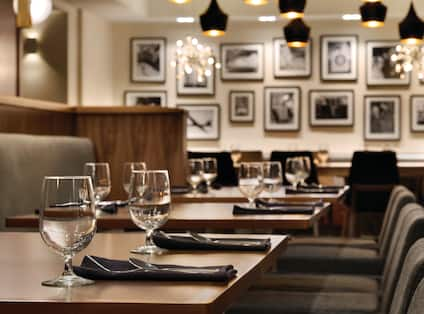 Close Up View of Dining Room Seating and Table Settings Within The Cloakroom Kitchen & Bar