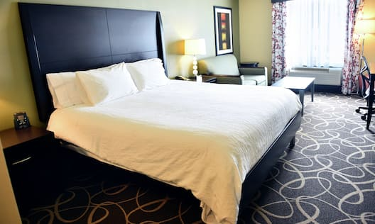 Guest Room with King Bed, Sofa and Work Desk
