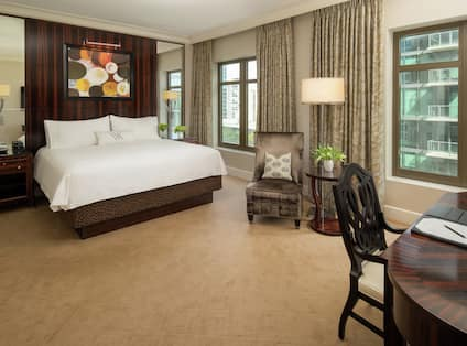 Premium King Guestroom with Bed, Lounge Area, and Work Desk