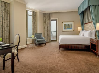 Presidential Guestroom Suite with Bed, Lounge Area, and Work Desk