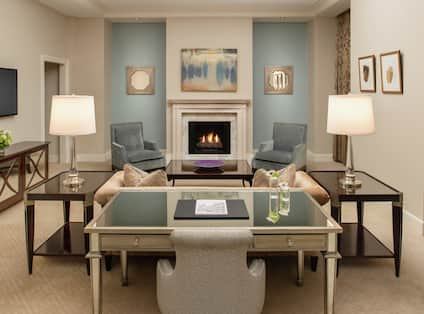 Presidential Suite Living Room with Lounge Area, Work Desk, and Room Technology