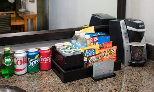 Close-Up of Snacks, Soft Drinks and Coffee Machine