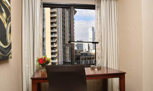 Desk in Front of Window with View of City