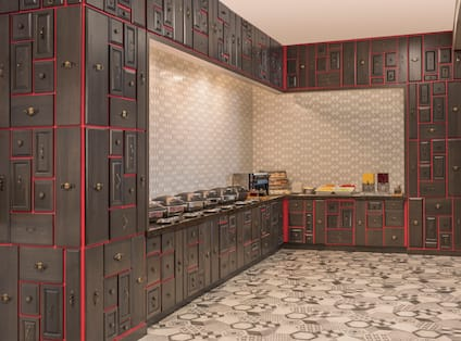 Wood Cabinets With Red Trim Surrounding Hot and Cold Breakfast Buffet in Texture Food & Drink