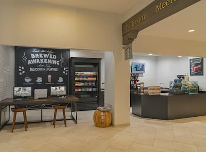 Chalkboard Signage Behind Business Center, and View of Beverages in Brewed Awakening Coffee Shop
