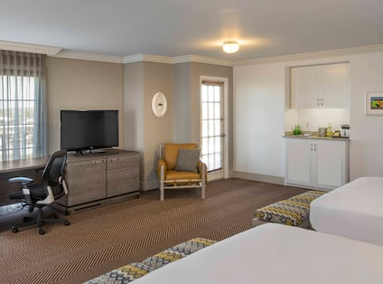 Premium Room With Two Double Beds, Work Desk, TV, Armchair, Hospitality Area, and Wall Art