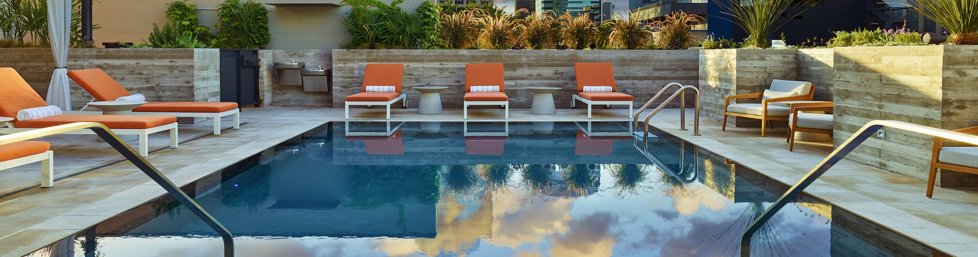 Outdoor pool with loungers