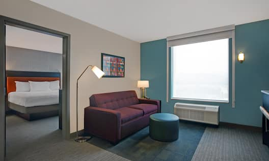 guest room with lounge area window and bed