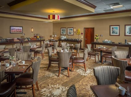 Ducker Tea Room With Dining Tables, Chairs, and Food Service Areas