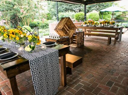 Flowers and Place Settings on Dining Tables of Patio of Tree House
