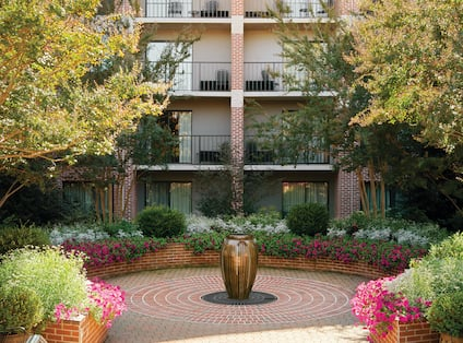 View of Hotel Balconies and Landscaping Surrounding Courtyard Area