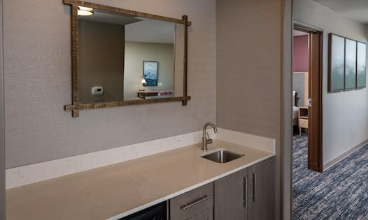 Wetbar in room with sink