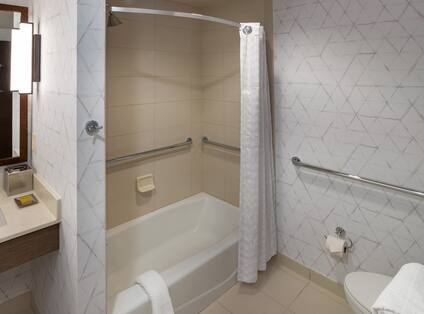 Bathroom with tub and shower