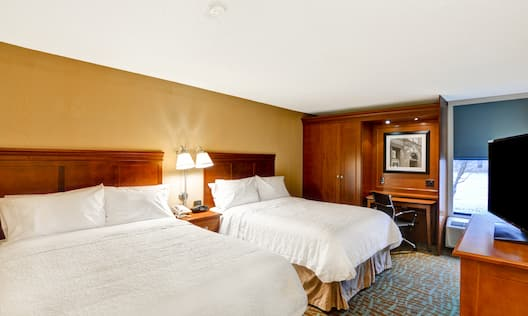 Guestroom with Two Queen Beds, Work Desk, Outside View and Television