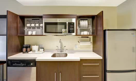 Kitchen Counter Area with Microwave, Dishwasher and Refridgerator