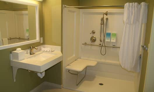 Accessible bathroom with sink and roll in shower