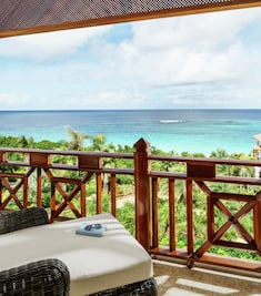 Balcony with lounger and sea view