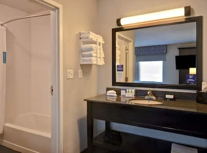 guest bathroom with vanity and tub