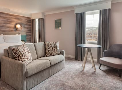 Sitting area in bedroom with comfortable seating