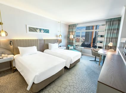 Two Twin Beds, Large Window and Hotel Amenities