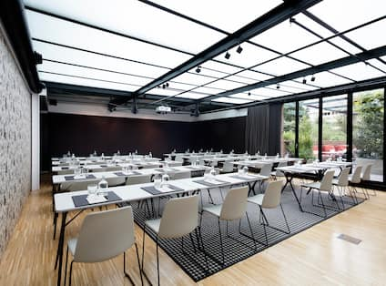 Alexandra Barcelona Curio Hotel Ballroom with Tables, Chairs, and Outside View