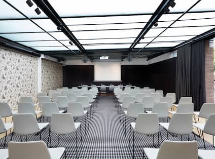 Alexandra Barcelona Curio Hotel Ballroom with Chairs and Projector Screen