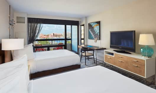 2 Queen beds in a Room with a Balcony View of Lake Boca , an HDTV, and a Writing Desk.