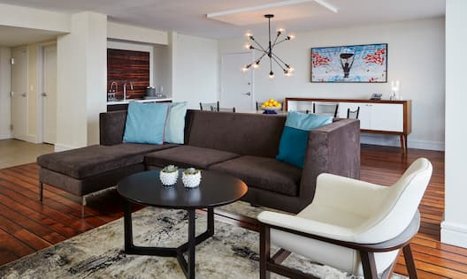 Parlor of the Presidential  Suite  Features a Sofa, Chair, Table, and a Wet Bar
