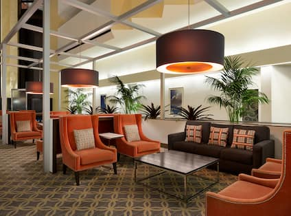 Pendant Lighting Above Armchairs, Sofas and Tables in Atrium Lounge Area