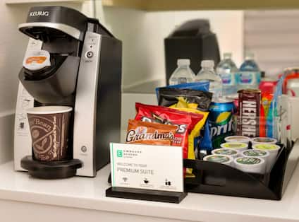 Detailed View of Keurig Coffee Maker, Signage, and Premium Suite Snack Tray