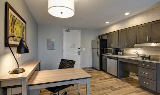 Desk and Kitchen Area in Suite