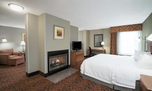 Studio Suite with King Bed, Fireplace, TV, Work Desk, and Lounge Area