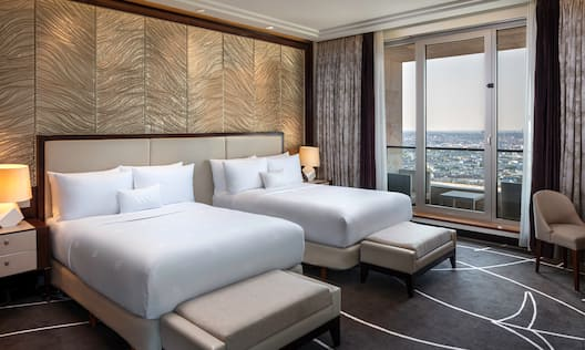 2 beds in room with balcony