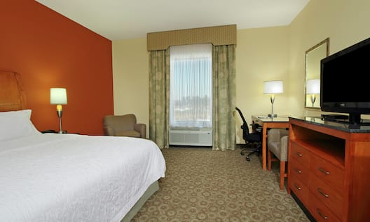 Accessible Guestroom with King Bed, Lounge Area, Work Desk, and Room Technology