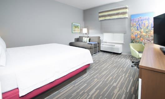 King Guestroom with Bed, Chair, Room Technology, and Lounge Area