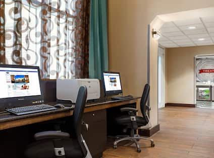 Business Center with Desktop Computers, Office Chairs and Printer