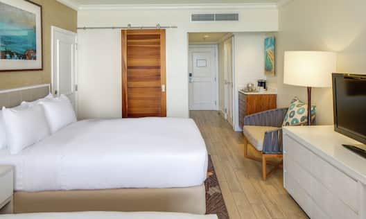 Guestroom with Double Beds, Lounge Area, and Room Technology