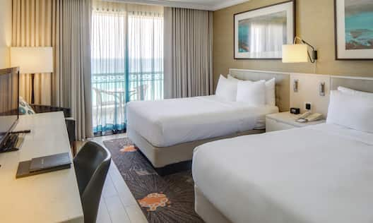 Premium Ocean View Guestroom with Double Beds, Lounge Area, Work Desk, and Room Technology