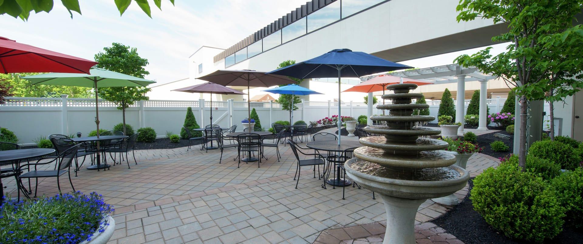 Tables With Sun Umbrellas on Carbo Garden Terrace