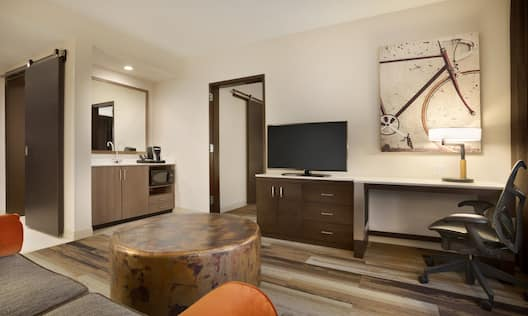 Guest Suite Living Area with HDTV, Sofa, Footrest and Work Desk